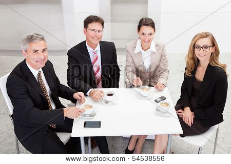 Business Executives Enjoying Coffee
