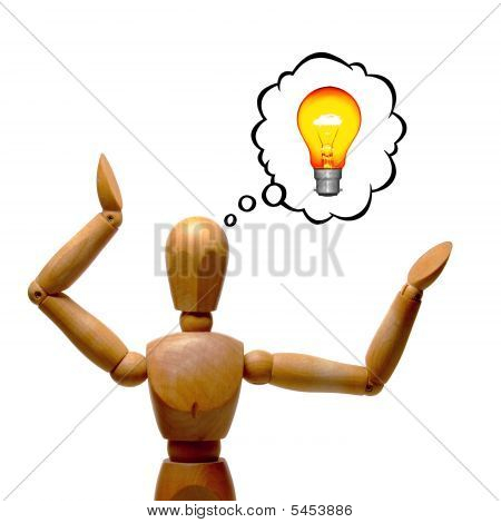 An artist's wooden manakin posed with a cartoon thought bubble containing a glowing light bulb. Isolated over pure white. poster