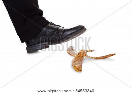 Businessman Slipping On Banana Peel