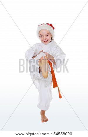 ?heerful sportswoman in a cap Santa Claus beat blow  insulated