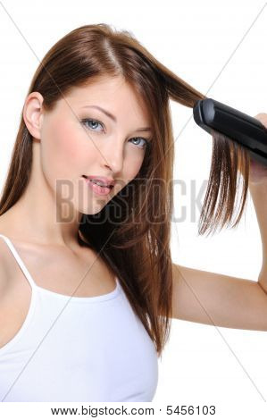 Beautiful Girl Doing Hairstyle With Hair Iron