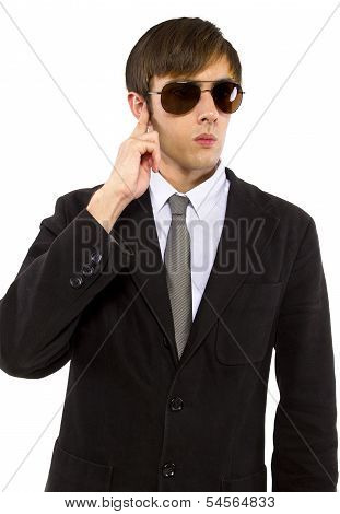 Caucasian male bodyguard wearing sunglasses and black suit poster