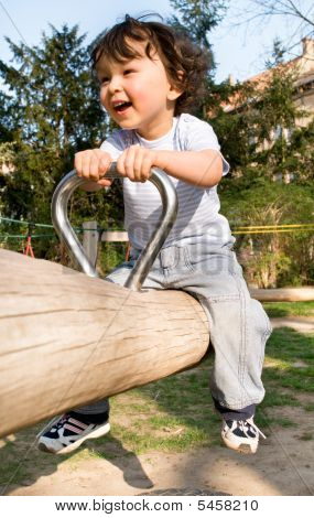 Little Boy On A Playground.
