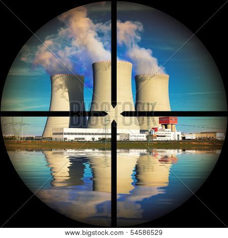 Nuclear power plant in a terrorist's weapon gunsight. Nuclear safety concept.  poster