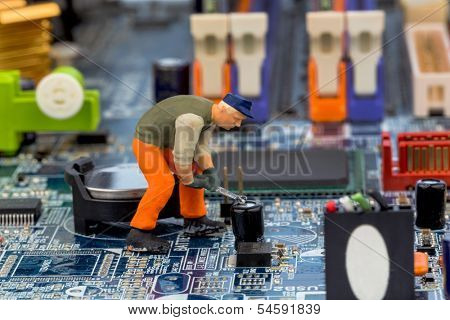 computer board and workers, symbol photo for computer failure, maintenance, data security