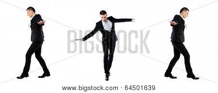Businessman walking on invisible rope in different directions