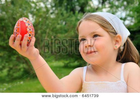 Little girl holding Easter egg