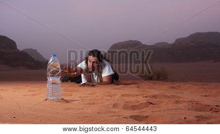 Desperate man in the desert longing for water