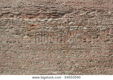 Old brick wall with the pattern for the archs