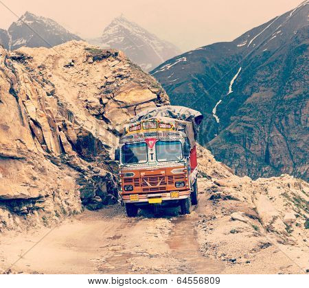 Vintage retro effect filtered hipster style travel image of Manali-Leh road in Indian Himalayas with lorry. Himachal Pradesh, India