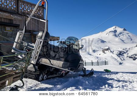 Snowmobile In The Mountains