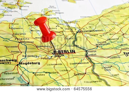 Close up of Berlin on a map with red pin poster
