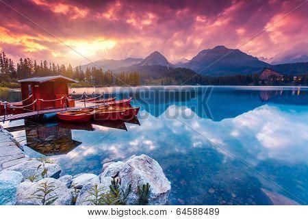 Peaceful mountain lake in National Park High Tatra. Dramatic overcast sky. Strbske pleso, Slovakia, Europe. Beauty world.
