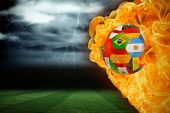 Composite image of fire surrounding international flag football against football pitch under stormy sky poster