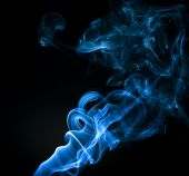 Blue smoke trail backit on a black background poster