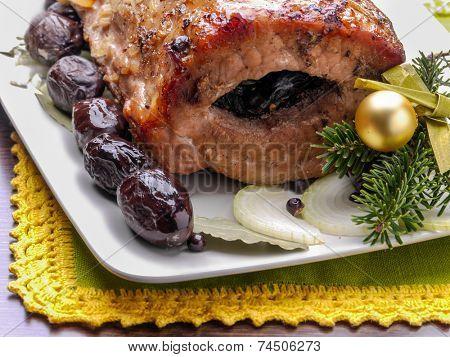 Plum staffed roasted pork loin served on plate