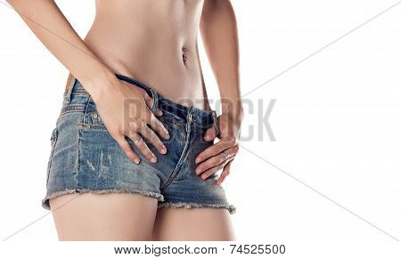 Perfect female belly. Slim figure in denim shorts on white background poster