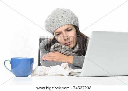 Sick Woman In Winter Attire With Laptop And Tea