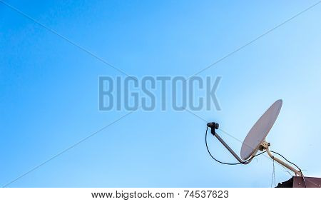 Satellite Dish With Blue Sky On Roof