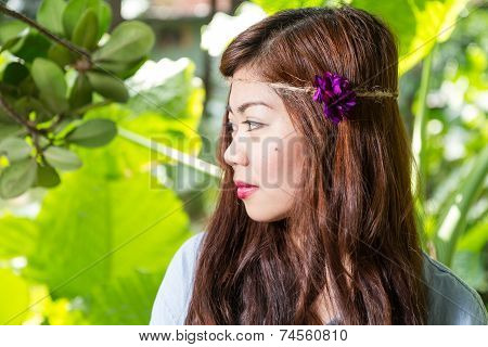 Side Profile Of Filipina Woman In A Garden