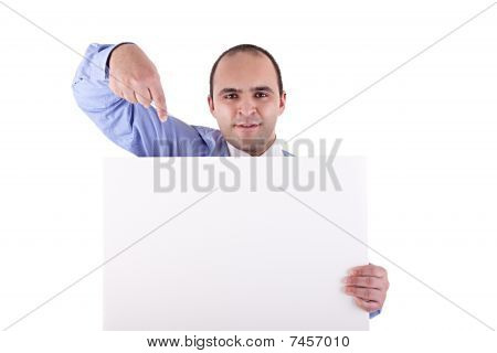 Young Businessman Holding A Whiteboard And Pointing, Looking At The Camera