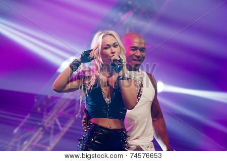 ASSEN, NETHERLANDS - OCTOBER 17, 2014: Dutch eurodance act Twenty 4 Seven performs on stage during a 80s and 90s party, hosted by David Hasselhoff.
