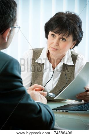 mid-adult man meeting with agent or advisor