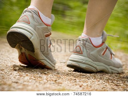 Woman jogging on parkway path