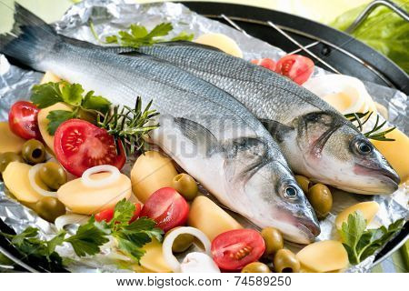 Sea-bass with the vegetables on a grill