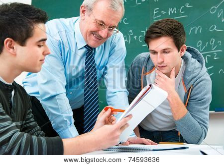 male students with a teacher in classroom