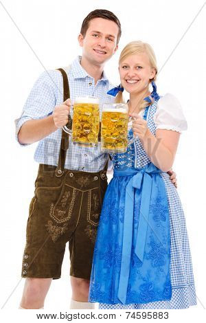 happy bavarian couple in dirndl with oktoberfest beer