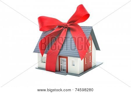 Real estate concept - house architectural model with red bow