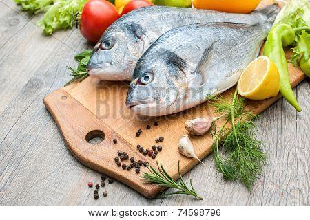 Fresh raw fish gilt head bream  a cutting board