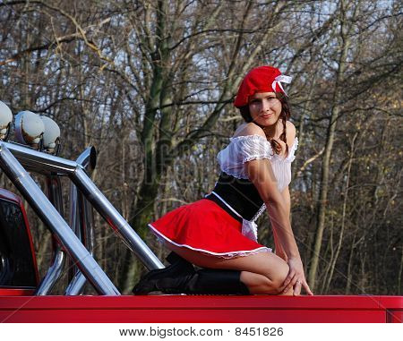 Sexy Girl On The Red Car.