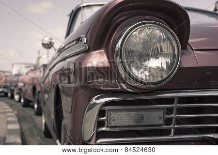 Close up of oldtimer headlight. Havana Cuba. Shallow DOF. Toned poster
