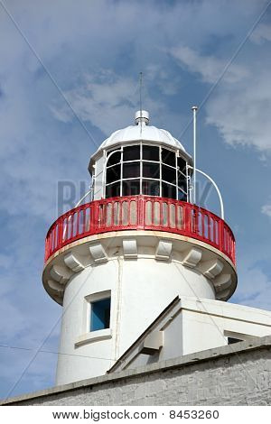 Lighthouse Isolated Against Clouds
