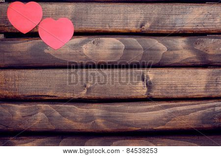 Red heart stickers on a wooden background
