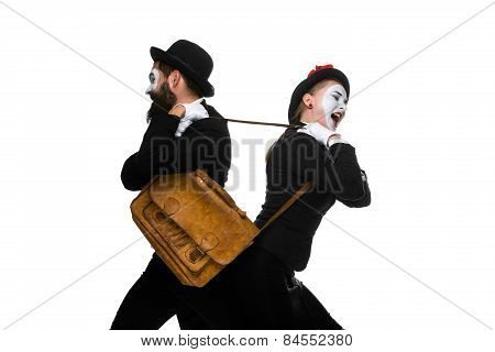 Two memes as business man and woman fighting over briefcase isolated on white background. the concept of the struggle for power and position poster