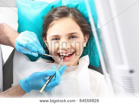 Dentist, child in the dental chair.