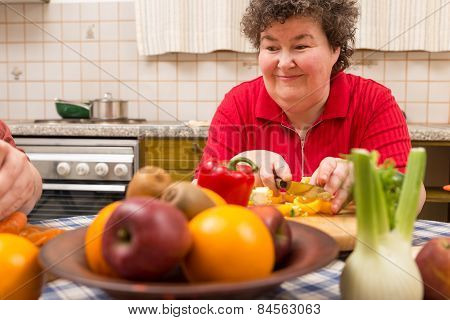 Mentally Disabled Woman Learns Cooking In The Kitchen