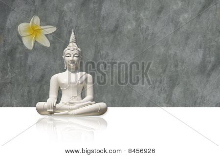 Isolated white buddha against grungy, grey background (incl. clipping path)