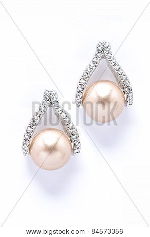 Earrings With Pearls And Diamonds On White Background