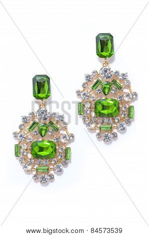 Emerald Earrings On A White Background