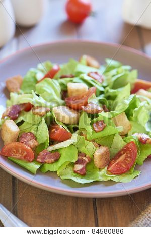 Caesar salad with smoked ham and cherry tomatoes