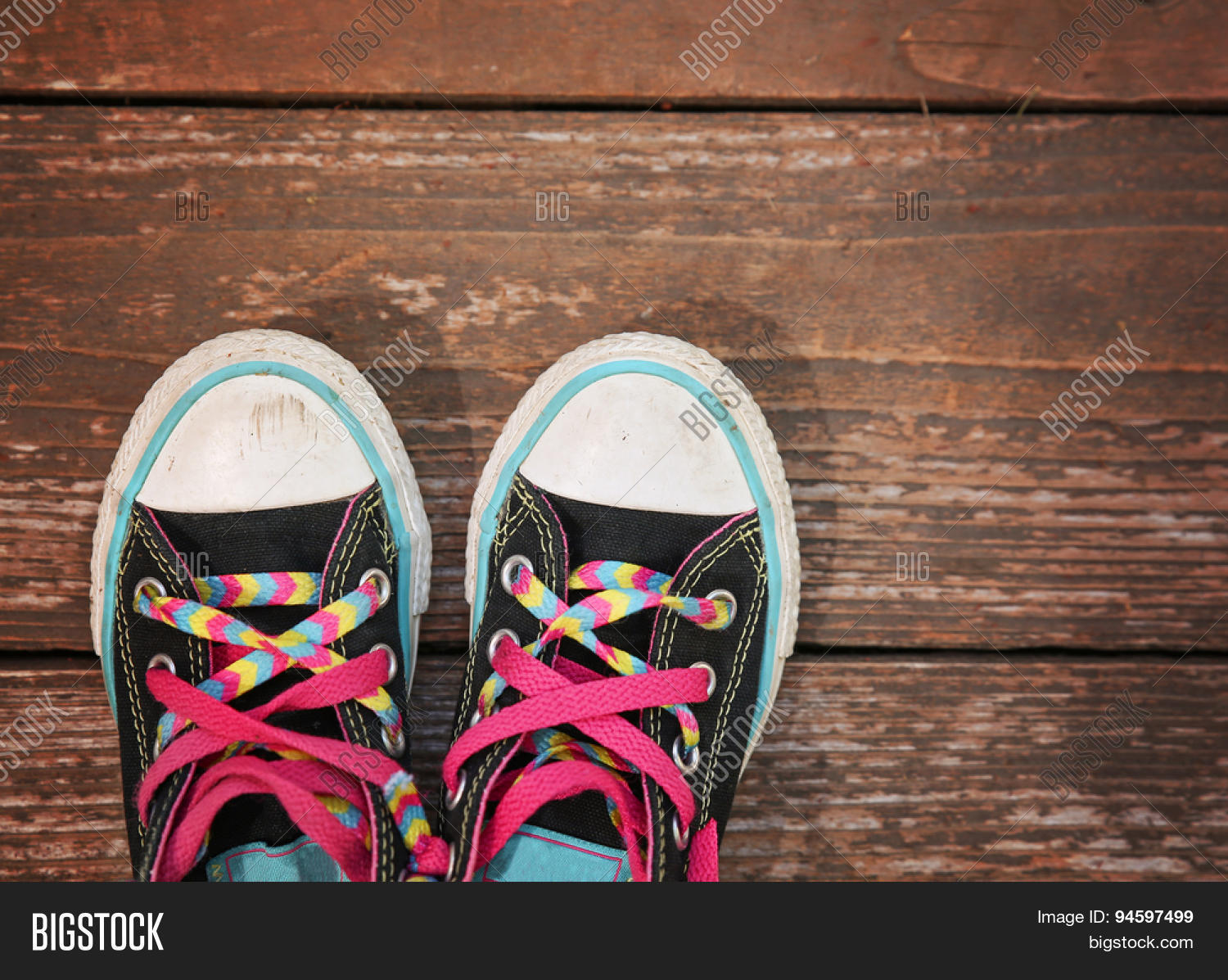 e757fa05fcba a wide angle photo of a pair of generic looking shoes like converse sneakers  with pink