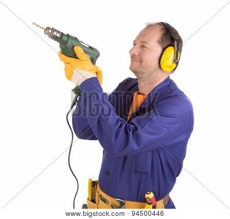 Worker in ear muffs with drill.