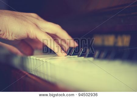 Hands Of Woman Pianist On Piano Keyboard