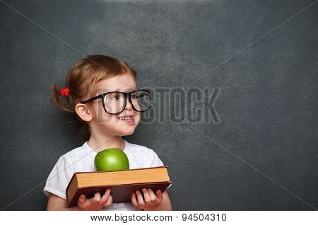 Girl Schoolgirl With Books And Apple In A School Board