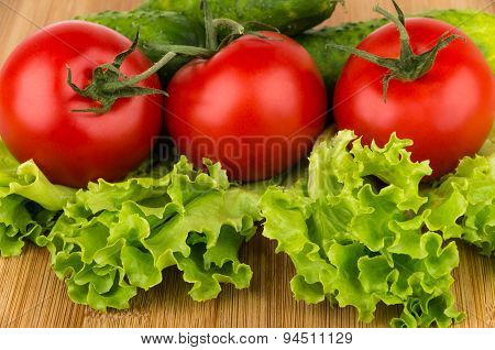 Ripe Tomatoes, Cucumbers And Lettuce On Board