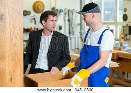 Boss And Worker In A Carpenter's Workshop